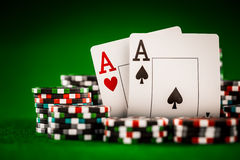 Chips and two aces. Stack of chips and two aces on the table on the green baize - poker game concept royalty free stock photography