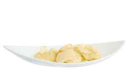 Chips on a white plate. On a white background Stock Photography