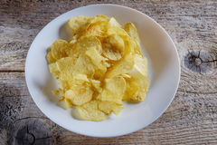 Chips in a white plate Stock Image