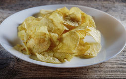 Chips in a white plate Stock Photos