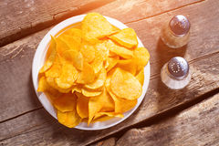 Free Chips With Salt And Pepperbox. Stock Photos - 70884793