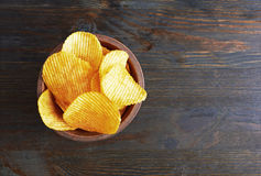 Chips on wooden background Stock Photography