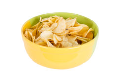 Chips in a yellow bowl Stock Images