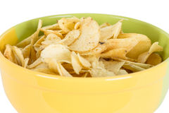 Chips in a yellow bowl Royalty Free Stock Photography