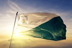 Chiquimula Department of Guatemala flag textile cloth fabric waving on the top sunrise mist fog. Beautiful stock photo