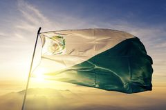 Chiquimula Department of Guatemala flag textile cloth fabric waving on the top sunrise mist fog. Beautiful royalty free stock image