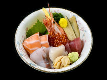 Chirashi sashimi don or mixed fresh sea food on rice in ceramic of Japanese tradition cuisine food. With black isolated background Stock Images