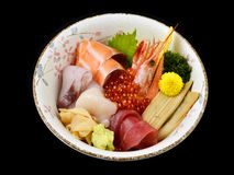 Chirashi sashimi don or mixed fresh sea food on rice in ceramic of Japanese tradition cuisine food. With black isolated background Royalty Free Stock Photos