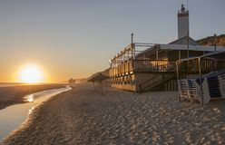 Chiringuito or beach bar at Costa de la Luz seashore, Spain. Chiringuito or beach bar at Costa de la Luz seashore, Matalascanas, Huelva. Sunset Royalty Free Stock Image