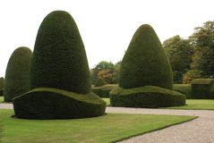 Chirk Castle Garden in Wrexham, Wales, England, Europe. Evening Autumn view of a formal yew topiary garden of a British Welsh tourist attraction castle with Stock Photography