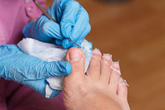 Chiropody Spa salon. Cleaning polish. Stock Photos