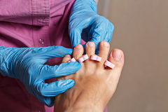 Chiropody Spa salon. Rubbing alcohol nails. Royalty Free Stock Image