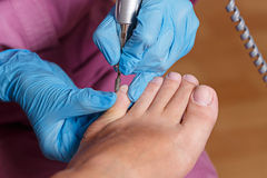 Chiropody Spa salon. Shaping nails and cuticles. Stock Images