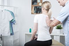 Chiropractic doing spinal mobilisation Stock Photos