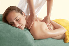 Chiropractic massage. And body therapy, portrait of a women with therapist Stock Images
