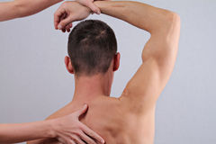 Chiropractic, osteopathy, pain relief concept. Dorsal manipulation therapist  doing healing treatment on man back Royalty Free Stock Photography