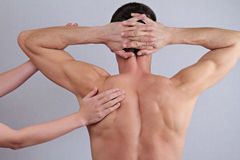 Chiropractic, osteopathy, pain relief concept. Dorsal manipulation therapist  doing healing treatment on man back Stock Images