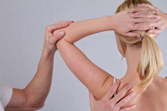 Chiropractic, osteopathy, pain relief concept. Dorsal manipulation therapist  doing healing treatment on woman back Stock Photography
