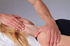Chiropractic, osteopathy.Therapist  doing healing treatment otreatment on woman's neck . Alternative medicin Stock Image