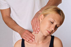 Chiropractic, osteopathy. Therapist  doing healing treatment otreatment on woman's neck . Alternative medicin Royalty Free Stock Photo