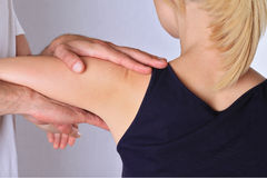 Chiropractic, osteopathy. Therapist  doing healing treatment treatment on woman's body . Alternative medicine Stock Photo