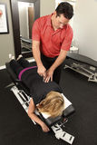 Chiropractor. Adjusting a female patient royalty free stock photo