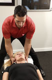 Chiropractor. Adjusting a female patient Royalty Free Stock Photography
