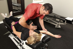 Chiropractor. Adjusting a female patient Royalty Free Stock Images