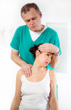 Chiropractor adjusting neck muscles Royalty Free Stock Photos
