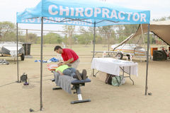 Chiropractor assisting cyclist at finish line at the Mathaithai Royalty Free Stock Photo