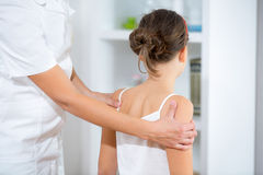 Chiropractor doing adjustment on female patient Royalty Free Stock Image
