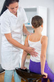 Chiropractor doing adjustment on female patient Royalty Free Stock Photography