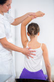 Chiropractor doing adjustment on female patient Royalty Free Stock Photo