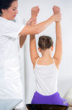 Chiropractor doing adjustment on female patient Royalty Free Stock Images