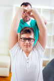 Chiropractor doing adjustment on patient Royalty Free Stock Photography