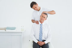 Chiropractor doing neck adjustment Royalty Free Stock Photography