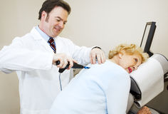 Chiropractor Enjoys His Work Stock Image