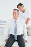 Chiropractor examining mature man Royalty Free Stock Images