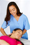 Chiropractor. Female chiropractor working at her office with a patient royalty free stock photography