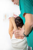 Chiropractor massage the female patient spine and back Royalty Free Stock Photos