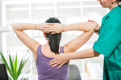 Chiropractor massage the patient spine and back. Chiropractor massage the female patient spine and back royalty free stock image