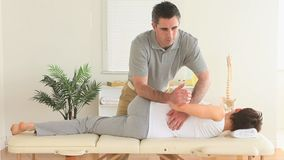 Chiropractor stretching a womans back stock video footage