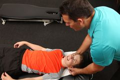 Chiropractor. A Chiropractor treating a child stock photo