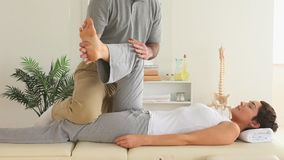 Chiropractor and woman doing special exercises stock footage