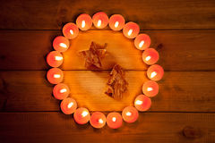 Chirstmas candles circle over wood and symbol Royalty Free Stock Photos