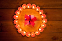 Chirstmas candles circle over wood and symbol Royalty Free Stock Photo