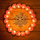Chirstmas candles circle over wood and symbol Stock Photo