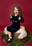 Chirstmas Child Laughing and Pointing; Red Holiday Winter Background Royalty Free Stock Photo