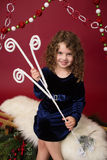 Chirstmas Child with Ornaments and Decorations, Red Holiday Wint Stock Photo