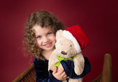 Chirstmas Child with Toy: Red Holiday Winter Background Stock Photos